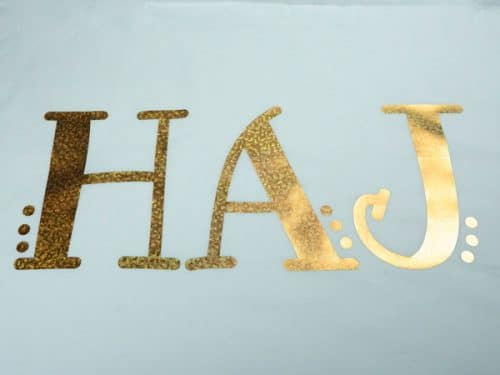 """A pillowcase with the initials """"HAJ"""" in Bubble Gold DecoFilm® Soft Metallics"""