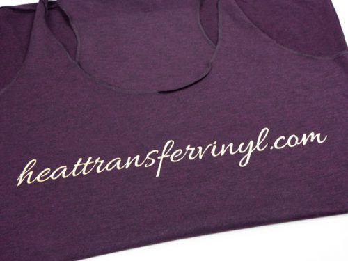 """A shirt with the words """"heattransfervinyl.com"""" in a scripty font made in Light Gold DecoFilm® Soft Metallics"""