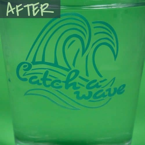 """A glass of cold water with a design that says """"Catch a wave"""" in Cold Blue Color Changing SpecialtyPSV™ after the cold water changes the color"""