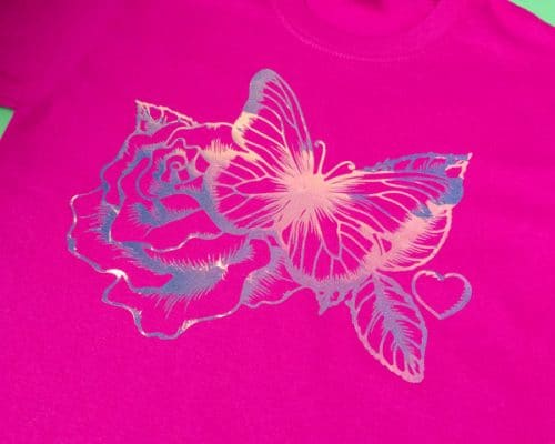 A butterfly with a flower behind it made with Blue DecoFilm® Glitter Chameleon