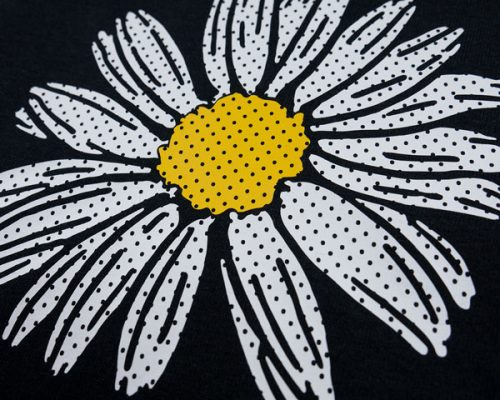 A flower made with White and Yellow FashionFlex® Perf